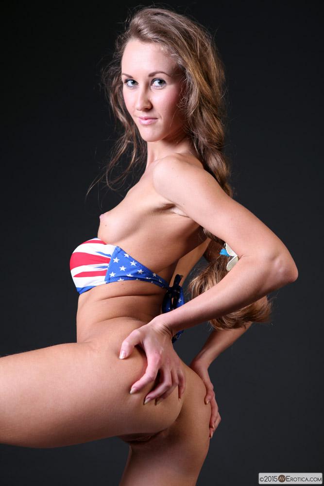 image Blondie in union jack panties poses seductively in bed